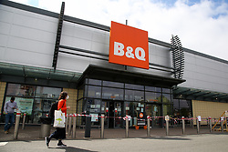 © Licensed to London News Pictures. 25/04/2020. London, UK. A woman wearing a face mask walks past B&Q, a DIY chain store in Tottenham Hale Retail Park, north London during the coronavirus lockdown. The lockdown continues to slow the spread of COVID-19 and reduce pressure on the NHS.  Photo credit: Dinendra Haria/LNP