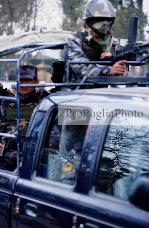 Members of the Armed Police Force patrolling the streets of Kathmandu during the nation's Democratic Day