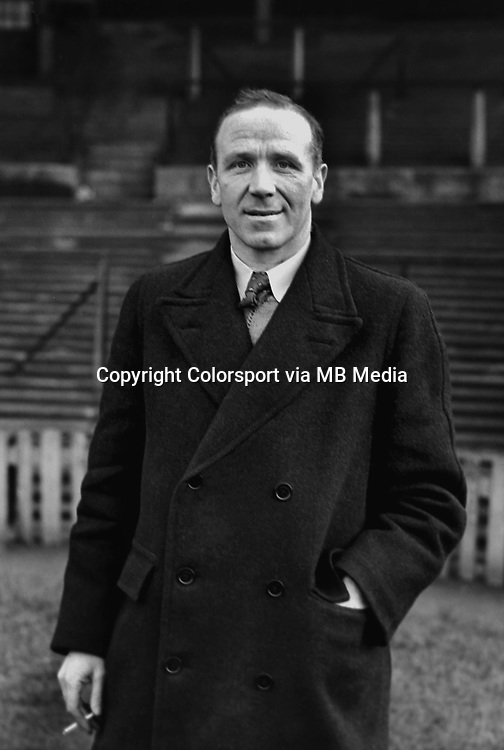 Matt Busby the Manager of Manchester United smoking a cigarette. 1947/48. Credit: Colorsport.