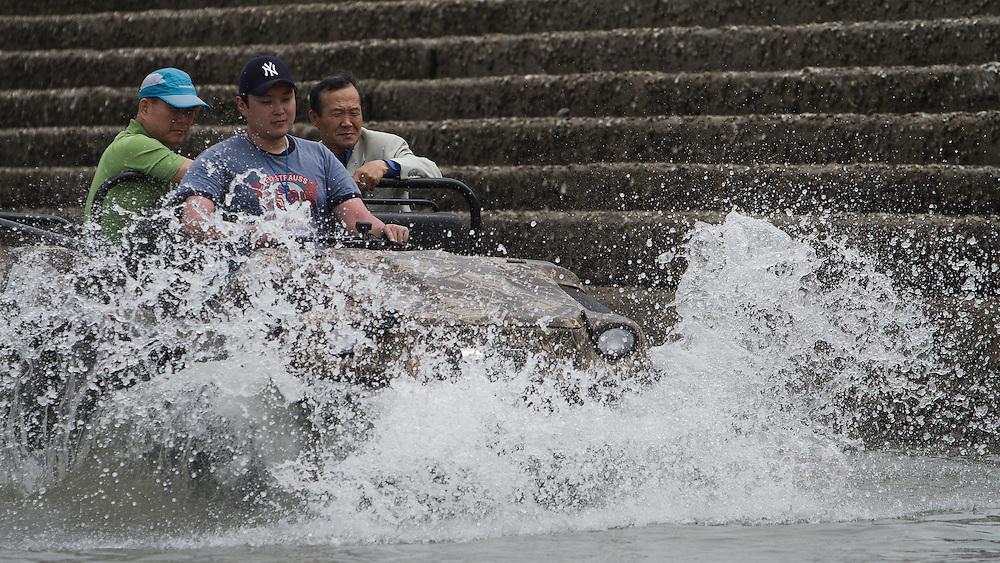 An amphibious vehicle enters the water at the 2011 Korea Match Cup. Gyeonggi Province, Korea. 9 June 2011. Photo: Subzero Images/Korea Match Cup