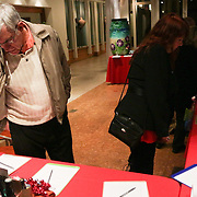 People browse raffle items Friday November 28, 2014 during the Atlantic Marine Holiday Flotilla Launch Party. (Jason A. Frizzelle)