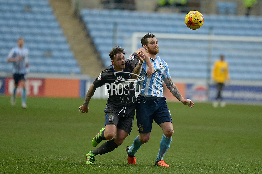 Bury Midfielder Andrew Tutte battles with Coventry City Midfielder Romain Vincelot during the Sky Bet League 1 match between Coventry City and Bury at the Ricoh Arena, Coventry, England on 13 February 2016. Photo by Dennis Goodwin.