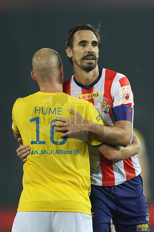 Borja Fernandez of Atletico de Kolkata and Iain Hume of Kerala Blasters FC embrace after the match during match 13 of the Hero Indian Super League between Atl&eacute;tico de Kolkata and Kerala Blasters FC held at the Salt Lake Stadium in Kolkata, West Bengal, India on the 26th October 2014.<br /> <br /> Photo by:  Ron Gaunt/ ISL/ SPORTZPICS