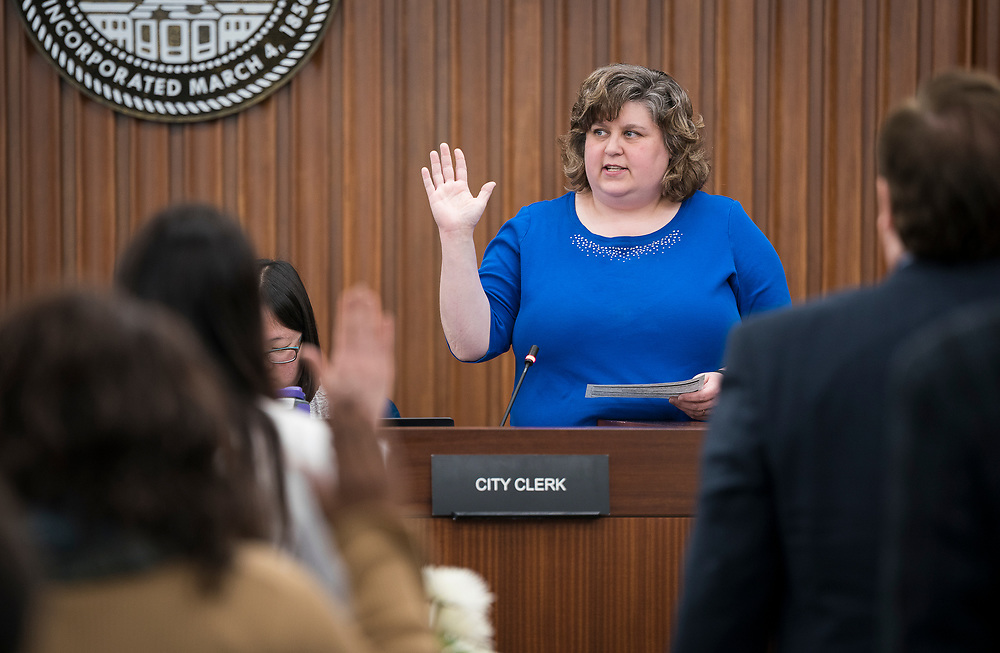 Madison City Clerk Maribeth Witzel-Behl swears in the incoming Alders at the City County Building in Madison, WI on Tuesday, April 16, 2019.