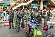19 JANUARY 2014 - BANGKOK, THAILAND: Thai police investigate the scene of an alleged grenade attack on anti-government protestors. Twenty-eight people were injured in the blasts. Hundreds of people came to Benjasiri Park, a few hundred meters from the anti-government protest site in Asok Intersection, Sunday evening to pray for peace and rally for a respect for democracy Sunday. The vigil took place a few hours after a two explosive devices, thought to be grenades, were thrown at the protest site near Victory Monument, several kilometers north of Asok. The grenade attack Sunday was the 2nd daytime grenade attack in three days on anti-government protestors. No arrests have been made in the incidents.    PHOTO BY JACK KURTZ
