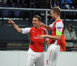 Arsenal's Lukas Podolski celebrates his goal with Arsenal's Per Mertesacker - Photo mandatory by-line: Dougie Allward/JMP - Mobile: 07966 386802 - 22/10/2014 - SPORT - Football - Anderlecht - Constant Vanden Stockstadion - R.S.C. Anderlecht v Arsenal - UEFA Champions League - Group D