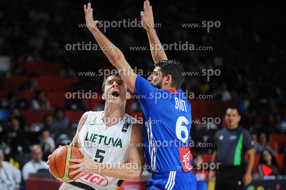 Adas Juskevicius of Lithuania vs Anoine Diot of France in action during the 2014 FIBA World Basketball Championship Third Place match between France and Lithuania at the Palacio de los Deportes, on September 13, 2014 in Madrid, Spain. Photo by Tom Luksys  / Sportida.com <br /> ONLY FOR Slovenia, France