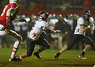 Solon's Aaron Shulista (2) avoids defenders as he runs for a touchdown during the first half of the game between the Solon Spartans and the Marion Indians at Thomas Park Field in Marion on Friday evening, October 5, 2012.