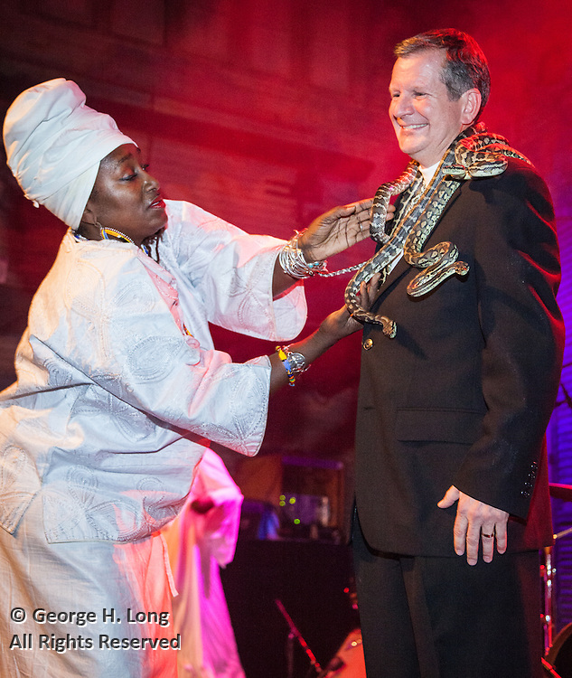 IAS President receives snakes from Priestess during the IAS Voodoo Magic Bash at the House of Blues