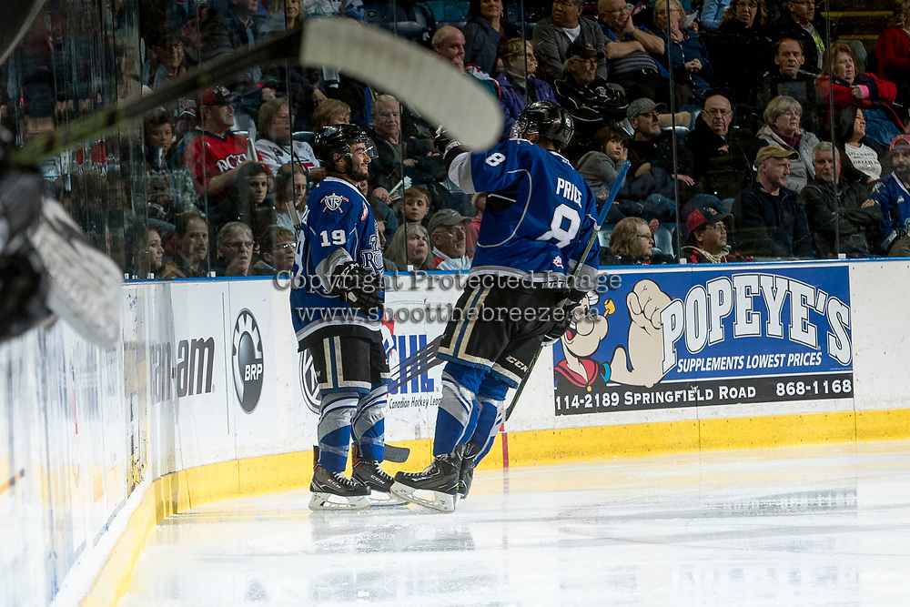 KELOWNA, CANADA - MARCH 11: Dante Hannoun #19 and Ethan Price #8 of the Victoria Royals celebrate a second period goal against the Kelowna Rockets on March 11, 2017 at Prospera Place in Kelowna, British Columbia, Canada.  (Photo by Marissa Baecker/Shoot the Breeze)  *** Local Caption ***
