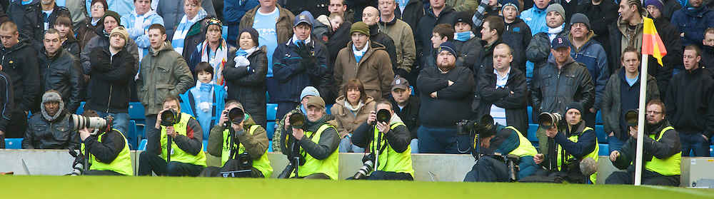 MANCHESTER, ENGLAND - Sunday, January 31, 2010: Photographers during the Premiership match between Manchester City and Portsmouth at the City of Manchester Stadium. (Photo by David Rawcliffe/Propaganda)