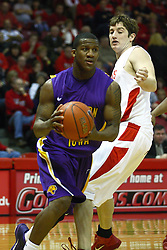 12 January 2011: Kwadzo Ahelegbe dribbles past Blake Mishler during an NCAA Missouri Valley Conference men's basketball game between the Northern Iowa Panthers and the Illinois State Redbirds at Redbird Arena in Normal Illinois.