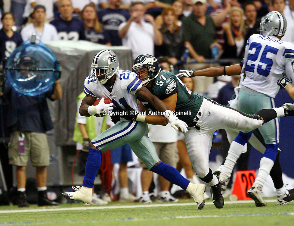 IRVING, TX - SEPTEMBER 15:  Cornerback Adam Jones #21 of the Dallas Cowboys returns a punt while trying to elude a tackle by Chris Gocong #57 of the Philadelphia Eagles at Texas Stadium on September 15, 2008 in Irving, Texas. The Cowboys defeated the Eagles 41-37. ©Paul Anthony Spinelli *** Local Caption *** Adam Jones;Chris Gocong
