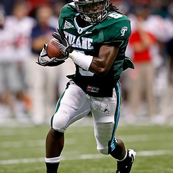 Sep 11, 2010; New Orleans, LA, USA; Tulane Green Wave wide receiver D.J. Banks (5) runs with the ball against the Mississippi Rebels during the second half at the Louisiana Superdome. The Mississippi Rebels defeated the Tulane Green Wave 27-13.  Mandatory Credit: Derick E. Hingle