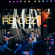 Jason Spooner performs to a packed crowd in Jackson, Wyoming. Band photographed through crowd.