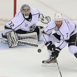 May 30, 2012: Los Angeles Kings goalie Jonathan Quick (32) tracks the puck with defenseman Rob Scuderi (7) first period action in game 1 of the NHL Stanley Cup Final between the New Jersey Devils and the Los Angeles Kings at the Prudential Center in Newark, N.J.