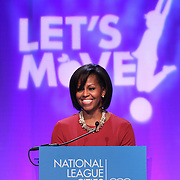 First Lady Michelle Obama speaks at a National League of Cities event in Washington, DC