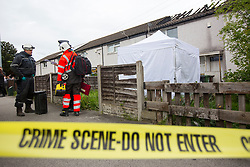 © Licensed to London News Pictures. 27/04/2017. Leeds UK. Picture shows Fire investigators at the scene of a house fire on Harehills lane in Leeds. A woman has been arrested after a man died following a house fire on Harehills Lane in Leeds early this morning. A man found at the scene was treated by firefighter and paramedics but was pronounced dead at the scene. A 28 year old woman has been arrested on suspicion of manslaughter & production of Cannabis after the remains of a cannabis growing set up were found at the property. Photo credit: Andrew McCaren/LNP