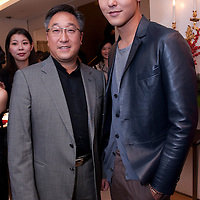 HONG KONG - NOVEMBER 27:  Nigel Luk (L), Cartier Managing director Far East and Taiwanese actor Ethan Ruan pose in the Cartier boutique as part of the Cartier Flagship Opening on November 27, 2010 in Hong Kong.  Photo by Victor Fraile / studioEAST *** Local Caption *** Nigel Luk; Ethan Ruan