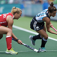 DEN HAAG - Rabobank Hockey World Cup<br /> 37 3rd Place match: Argentina - USA<br /> Foto: Gisele Juarez (blue) and Kelsey Kolojejchick (red).<br /> COPYRIGHT FRANK UIJLENBROEK FFU PRESS AGENCY