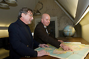 Explorers Club members Carl Schuster (front), an cartographic expert, and Ross von Burg, an explorer who has sailed extensively and is an expert on civilian future space travel, at the club's map room...Founded in New York City in 1904, The Explorers Club promotes the scientific exploration of land, sea, air, and space by supporting research and education in the physical, natural and biological sciences. The Club's members have been responsible for an illustrious series of famous firsts: First to the North Pole, first to the South Pole, first to the summit of Mount Everest, first to the deepest point in the ocean, first to the surface of the moon--all accomplished by our members.