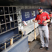 NEW YORK, NEW YORK - July 09: Daniel Murphy #20 of the Washington Nationals puts his bat in the bat rack before the Washington Nationals Vs New York Mets regular season MLB game at Citi Field on July 09, 2016 in New York City. (Photo by Tim Clayton/Corbis via Getty Images)