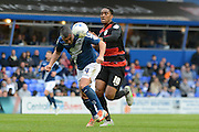 Birmingham City defender Paul Robinson heads away from Queens Park Rangers midfielder Leroy Fer during the Sky Bet Championship match between Birmingham City and Queens Park Rangers at St Andrews, Birmingham, England on 17 October 2015. Photo by Alan Franklin.