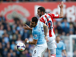 Manchester City's Alvaro Negredo and Stoke City's Marc Wilson battle for an aerial ball - Photo mandatory by-line: Matt Bunn/JMP - Tel: Mobile: 07966 386802 14/09/2013 - SPORT - FOOTBALL -  Britannia Stadium - Stoke-On-Trent - Stoke City V Manchester City - Barclays Premier League