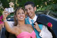 Teenage Girl Snapping Photo at Prom
