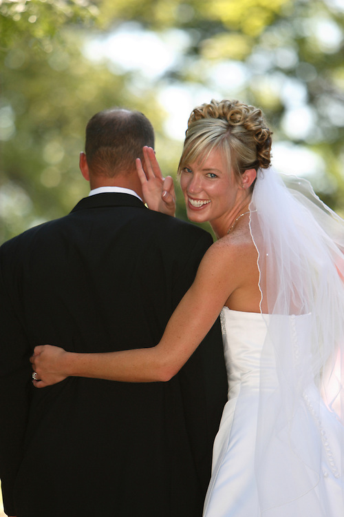 Heidi and Bradon Atkinson get married at the David B. Haight home at Utah State University in Logan, Utah on July 14, 2006. August Miller<br />