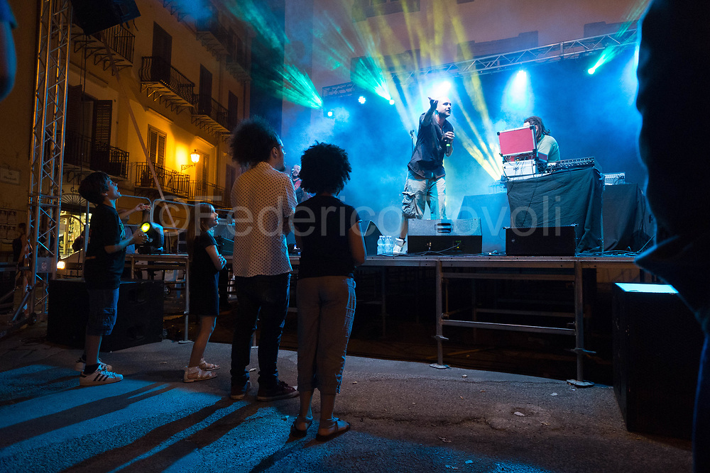"""Christian """"Picciotto"""" Paterniti & The Gold Diggers, sings in sicilian dialect using  rap rhythms in the Piazza Professa at the final festival of Mediterranean Anti-racist, a multiethnic football champinship"""