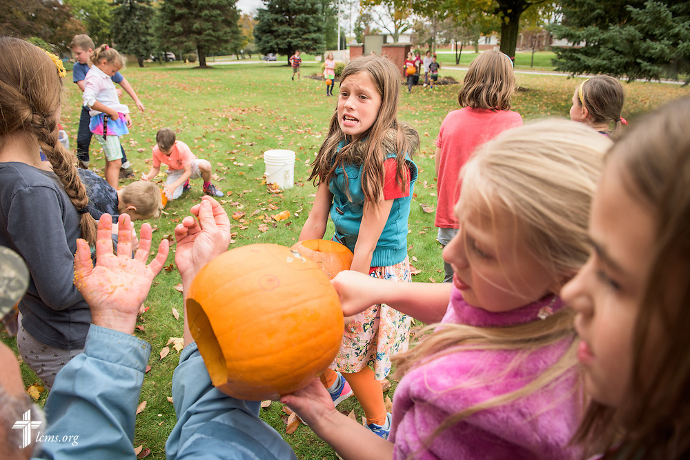 4th grade students carry and mark pumpkins for carving during an outside classroom activity on Thursday, Oct. 27, 2016, at First Immanuel Lutheran School in Cedarburg, Wis. LCMS Communications/Erik M. Lunsford