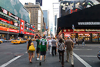Pedestrians cross the intersection near Times Square, Manhattan, New York, USA
