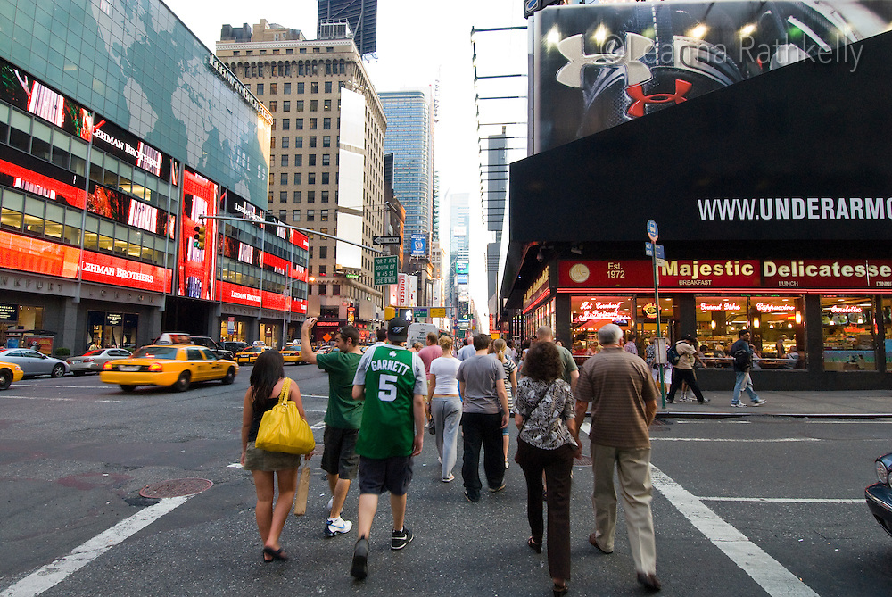 Pedestrians cross the intersection near Times Square, Manhattan, New York, USA