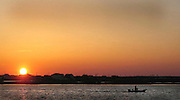 STONE HARBOR,NJ- A fisherman heads out in his boat  at sunset, April 20, 2003.