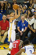 Golden State Warriors guard Stephen Curry (30) shoots a 3 pointer during a NBA preseason game against the Los Angeles Clippers at Oracle Arena in Oakland, Calif., on October 4, 2016. (Stan Olszewski/Special to S.F. Examiner)