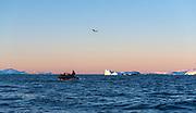 Spectacular light during sunset and dusk at Hydruga Rocks, the Palmer Archipelago, Antarctica.