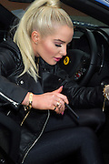 29.JANUARY.2014. MANCHESTER<br /> <br /> CODE - DSED<br /> <br /> FORMER CORONATION STREET ACTRESS HELEN FLANAGAN LAUNCHES NEW E-CIGARETTE BRAND KIK BY POSING WITH TWO SUPERCARS, THE LAMBORGHINI AVENTADOR ROADSTER CONVERTIBLE AND A 458 FERRARI SPIDER<br /> <br /> BYLINE: EDBIMAGEARCHIVE.CO.UK<br /> <br /> *THIS IMAGE IS STRICTLY FOR UK NEWSPAPERS AND MAGAZINES ONLY*<br /> *FOR WORLD WIDE SALES AND WEB USE PLEASE CONTACT EDBIMAGEARCHIVE - 0208 954 5968*