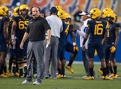 Sep 5, 2015; Morgantown, WV, USA; West Virginia Mountaineers head coach Dana Holgorsen walks up the side line during the first half at Milan Puskar Stadium. Mandatory Credit: Ben Queen-USA TODAY Sports