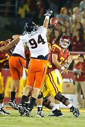 September 11, 2010; Los Angeles, CA, USA;  Virginia Cavaliers defensive end Matt Conrath (94) blocks a pass from Southern California Trojans quarterback Matt Barkley (7) during the first quarter at the Los Angeles Memorial Coliseum. USC defeated Virginia 17-14.