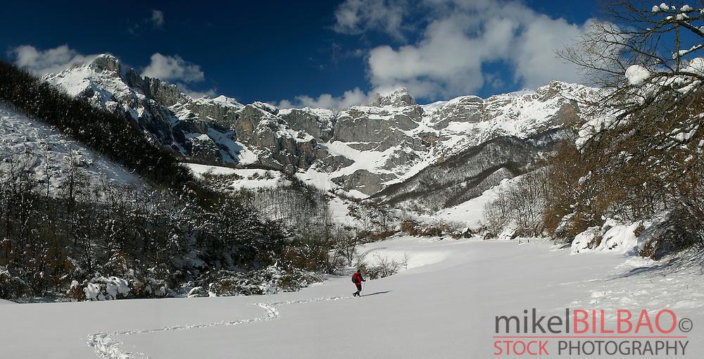 Mountaineer in Fuente De glacier cirque in winter.<br /> Picos de Europa National Park. Cantabria, Spain.