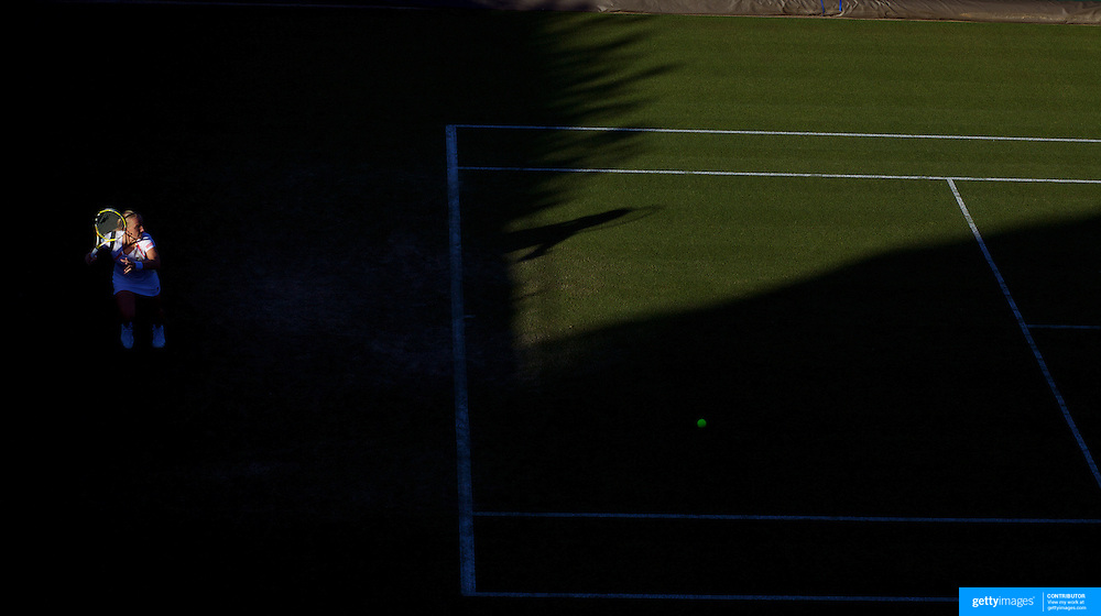 Svetlana Kuznetsova, Russia, in action against Akiko Morigami, Japan in the late eveing light  during the first round match at the All England Lawn Tennis Championships at Wimbledon, London, England on Tuesday, June 23, 2009. Photo Tim Clayton..
