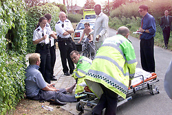Linford Christie drives his car into photographer Ian Vogler  outside his house at Iver, Bucks, August 5, 1999. Photo by Andrew Parsons / i-images..