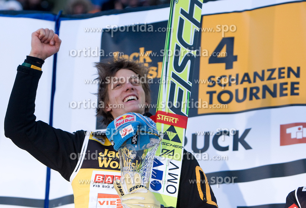 Winner Gregor Schlierenzauer of Austria celebrates at the medal ceremony after he competed in the Final Round of the FIS Ski Jumping World Cup event of the 58th Four Hills ski jumping tournament, on January 3, 2010 in Bergisel, Innsbruck, Austria.(Photo by Vid Ponikvar / Sportida)
