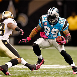 October 3, 2010; New Orleans, LA, USA; Carolina Panthers wide receiver Steve Smith (89) runs from New Orleans Saints safety Usama Young (28) during the second half at the Louisiana Superdome. The Saints defeated the Panthers 16-14. Mandatory Credit: Derick E. Hingle
