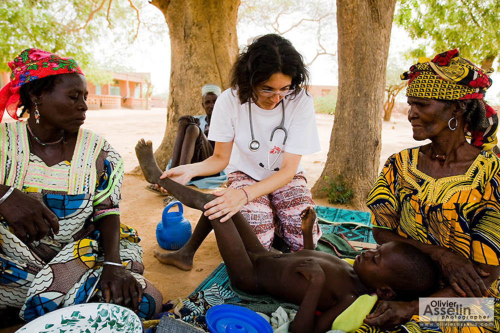 MSF medical doctor Emma Manfrin examines seven-year-old Salissou Souley, who was infected with both meningitis and malaria, at the Aguie government hospital in the town of Aguie, roughly 80 km east of Maradi, Niger on Friday April 17, 2009.