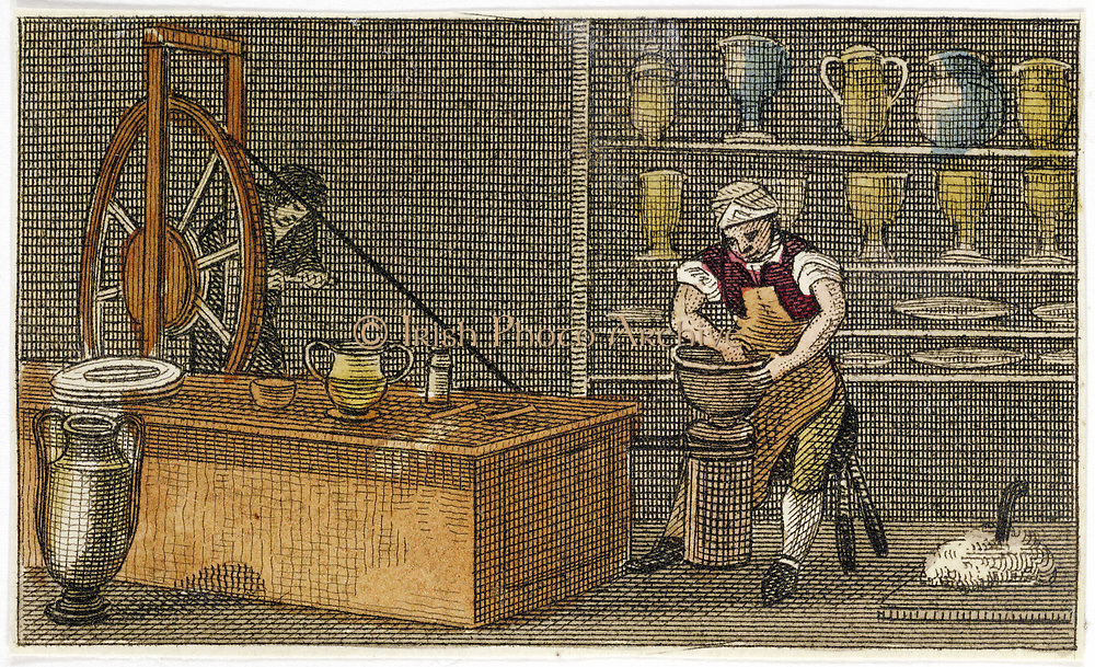 Potter at work at the Wedgwood's Etruria factory, Hanley, Staffordshire. Assistant turns wheel to operate belt driving potter's wheel. Josiah Wedgwood (1730-1795) English potter and industrtialist. Hand-coloured engraving c1830.