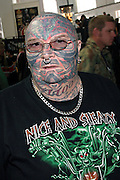 Portrait of one of the visitors of the 2nd International Tattoo Convention in London on Saturday, Oct. 7, 2006, in London, UK. With over 15.000 visitors in three days during the 2005 edition, the event placed London in a central position in the tattoo world.  This year about 150 artists ,representing all the tattoo styles, are ticking away with their machines in a very exciting atmosphere. **ITALY OUT**....