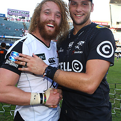 DURBAN, SOUTH AFRICA - MARCH 10: Willem Britz (captain) of the HITO-Communications Sunwolves with Ruan Botha of the Cell C Sharks during the Super Rugby match between Cell C Sharks and Sunwolves at Jonsson Kings Park Stadium on March 10, 2018 in Durban, South Africa. (Photo by Steve Haag/Gallo Images)
