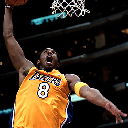 Los Angeles: Kobe Bryant of the Los Angeles Lakers slam dunks on the Memphis Grizzlies at the Staples Center Nov 9,2001.